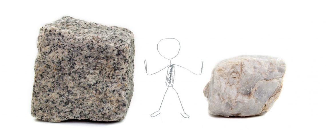 a stick figure stands between a rock and a hard place